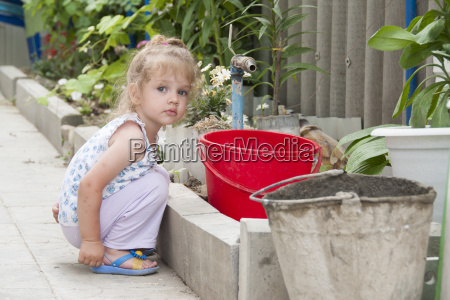 girl standing in the garden with