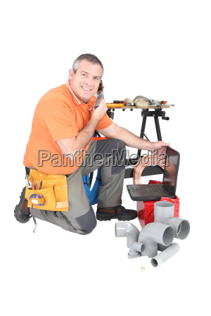 plumber with materials laptop and cellphone