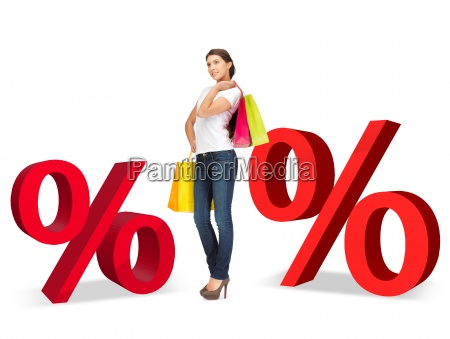 woman with shopping bags and percent