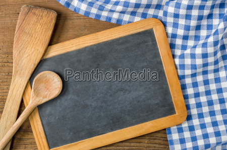 slate with cooking spoons on a