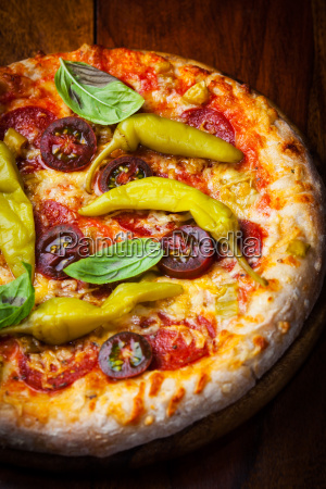 homemade pizza with dried tomatoes and
