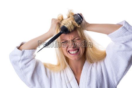 blonde with hairbrush in hand