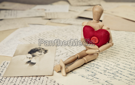 manikin with fabric heart and old