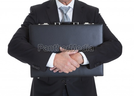 close up of businessman holding briefcase