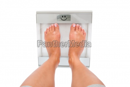 close up of womans feet measuring