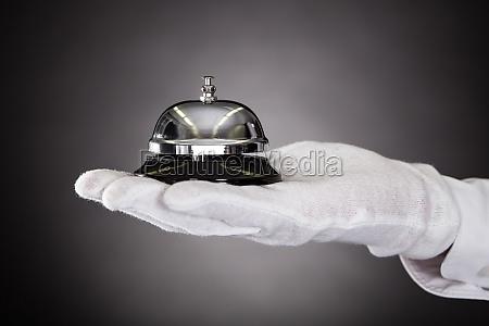 hand holding service glocke