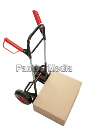 brown cardboard box on hand truck