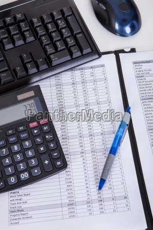 financial papers calculator and pen