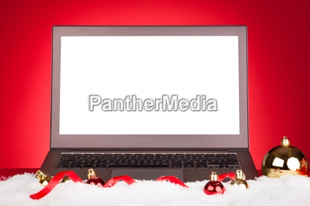 blank laptop with christmas baubles