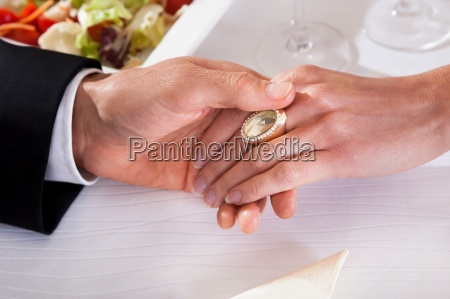 man and woman holding hands over