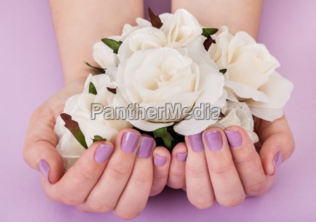 close up of hands holding white