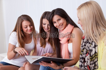four female friends looking at a