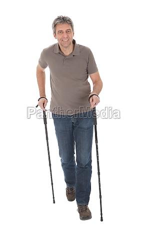 senior man with hiking poles