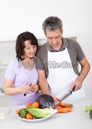 senior couple cooking lunch at home