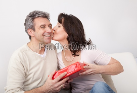 man giving a present to woman