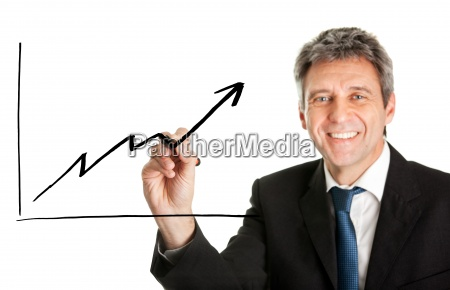 businessman writing a financial graph