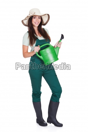 beautiful happy woman holding watering can