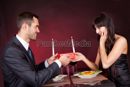 man giving present to a woman