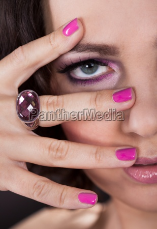 young woman with pink nail varnish