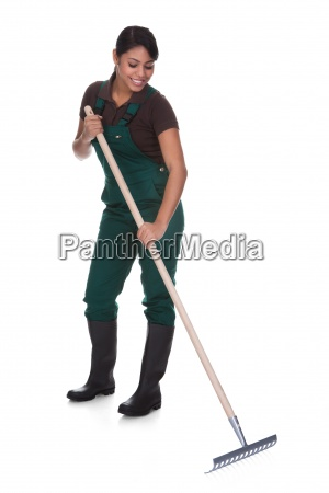 young female gardner with gardening tools