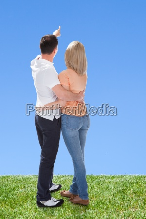portrait of couple looking at sky