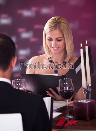 young woman choosing menu