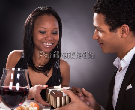 african couple with a gift in