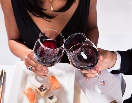 romantic couple toasting red wine