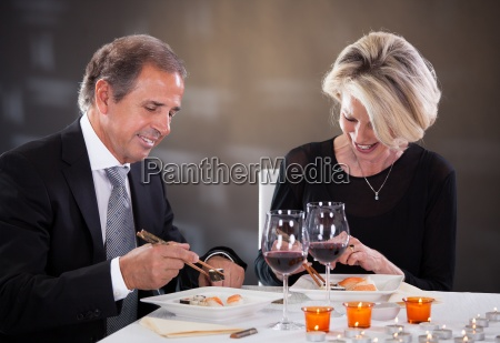 mature couple sitting in a restaurant