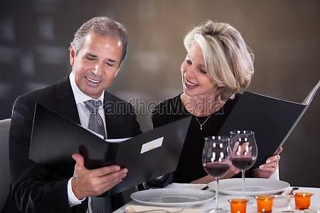 mature couple choosing menu