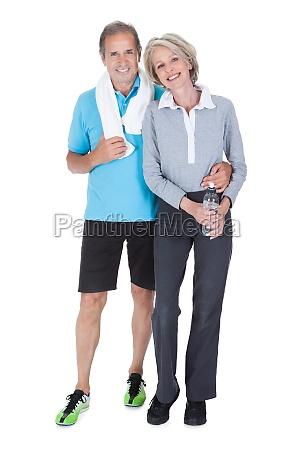 happy mature couple in fitness attire