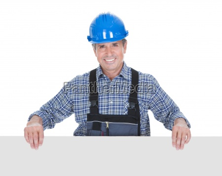 happy worker pointing on placard