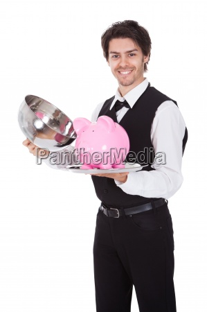 portrait of a butler with piggybank