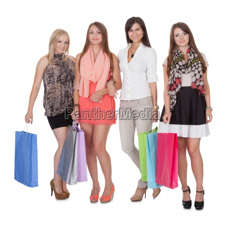 four happy female shoppers