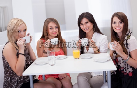 stylish woman having coffee