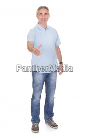 mature man offering handshake