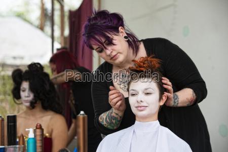 stylist fixing haar