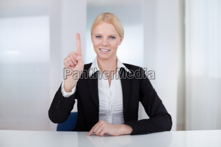 business woman touching the screen with