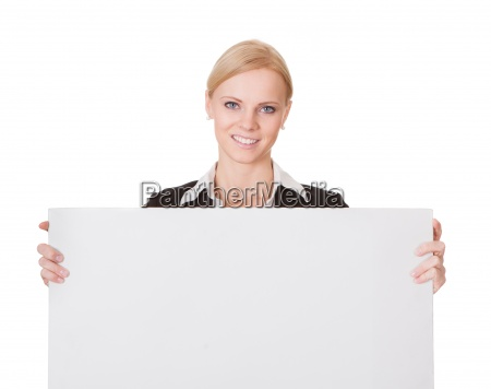businesswoman presenting empty banner