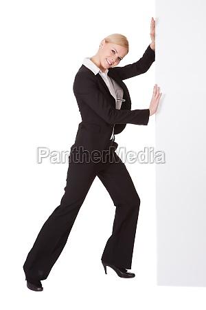 businesswoman pushing banner