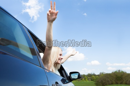 young woman raising hand out of