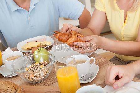 happy family enjoying breakfast