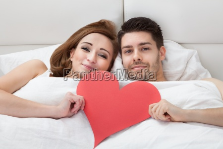 portrait of young loving couple lying