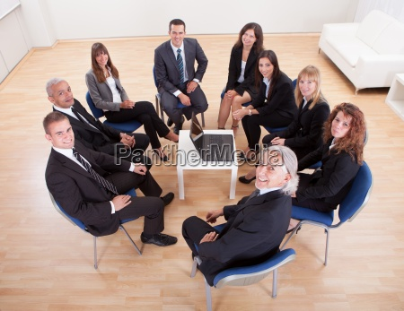 group of business people sitting on