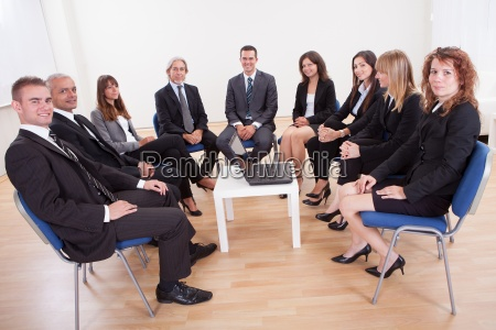successful happy business people sitting on