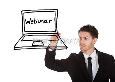 man drawing image on blackboard