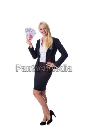 blonde holds money in hand