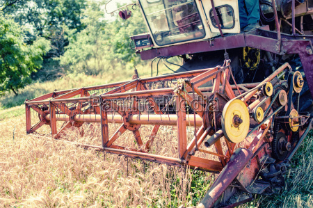 close up of harvesting combine in
