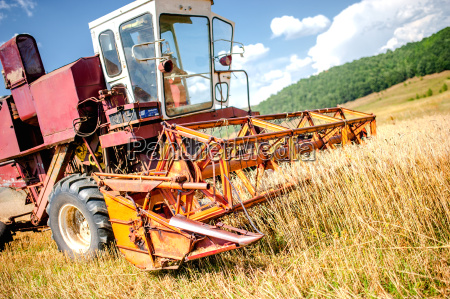 harvesting machinery in wheat and grain