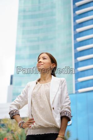 business woman walking proud city office